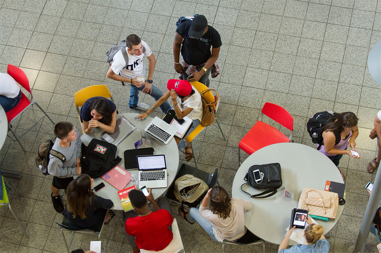 Aerial view of a group of students studying together at the student union.