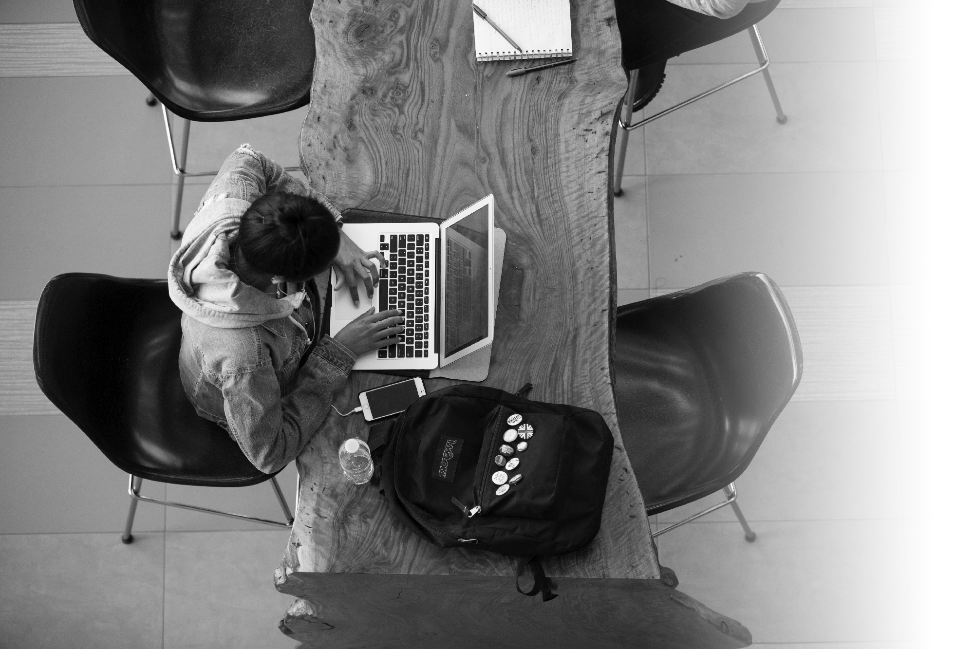 A student studying on a laptop captured from above.